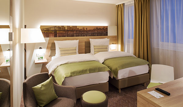 Standard Twin Bed at Holiday Inn Frankfurt Airport, Germany